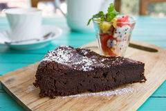 Chocolate cake with fruits salad Stock Images