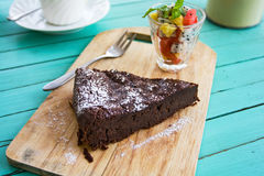 Chocolate cake with fruits salad Royalty Free Stock Images