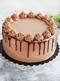 Chocolate Cake with Fudge Drizzled Icing and Curls Stock Photos