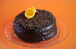 Chocolate cake with ganache, shavings and orange peel Stock Photos