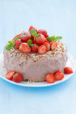 chocolate cake garnished with fresh strawberries on blue Stock Photos