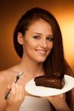 Chocolate cake - glamorous woman eats dessert Royalty Free Stock Image