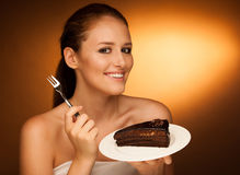 Chocolate cake - glamorous woman eats dessert Stock Photo