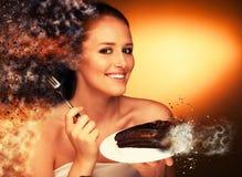 Chocolate cake - glamorous woman eats dessert Royalty Free Stock Photography