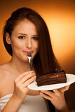 Chocolate cake - glamorous woman eats dessert Stock Photo