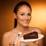 Chocolate cake - glamorous woman eats dessert Stock Images