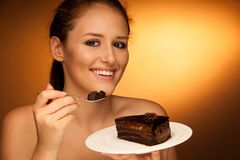 Chocolate cake - glamorous woman eats dessert Stock Image