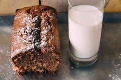 Chocolate cake with a glass of milk on baking tray Stock Photo
