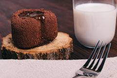 Chocolate cake and glass of milk on a brown table, fork on the t Royalty Free Stock Photo