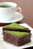 Chocolate cake with green tea powder Stock Photos