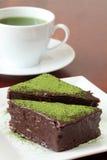 Chocolate cake with green tea powder Stock Photos