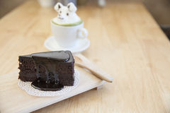 Chocolate cake and  green tea topping made by milk foam top on t Royalty Free Stock Photos