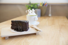 Chocolate cake and  green tea topping made by milk foam top on t Stock Images