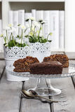 Chocolate cake on grey wooden table Stock Photos