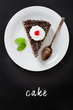 Chocolate cake with hand lettering text written on a chalkboard. Overhead view Royalty Free Stock Image