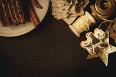 Chocolate cake and handmade Christmas decorations Royalty Free Stock Image