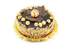 Chocolate cake with hazelnuts. Isolated on white background Stock Images