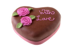 Chocolate Cake heart shape with icing sugar flowers. Stock Images