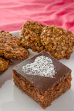 Chocolate cake and home made cookies Royalty Free Stock Images