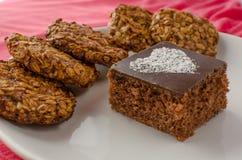 Chocolate cake and home made cookies stock photos