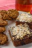 Chocolate cake and home made cookies Stock Image
