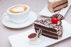 Chocolate cake with hot coffee Stock Photography