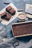 Chocolate cake and hot coffee with milk. stock images