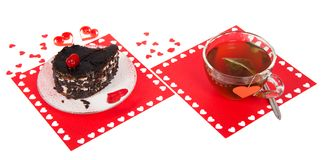 Chocolate cake and hot tea on a red napkin Stock Photos