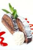 Chocolate cake with ice cream and strawberry sauce Stock Photography