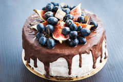 Chocolate cake with icing, decorated with fresh fruit Royalty Free Stock Image