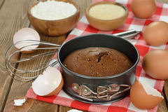 Chocolate cake and ingredients for baking Royalty Free Stock Photography