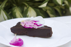 Chocolate cake. Italian chocolate cake with flowers Royalty Free Stock Images