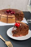 Chocolate cake with juicy cherries stock photography