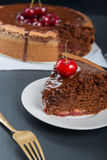 Chocolate cake with juicy cherries Royalty Free Stock Images