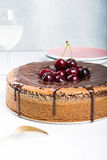 Chocolate cake with juicy cherries Stock Images