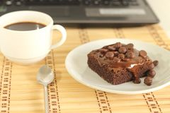 Chocolate cake and  labtop Stock Image