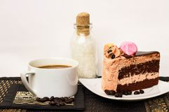 Chocolate cake with latte coffee and white sugar on the wooden t. Coffee cup and cake chocolate with sugar stock images