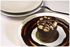 Chocolate cake with macadamia. Chocolate fudge Stock Photo