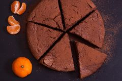 Chocolate cake with mandarin. On the table Royalty Free Stock Images