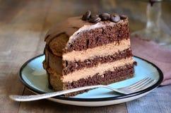 Chocolate cake. Chocolate cake with mascarpone on rustic background royalty free stock image