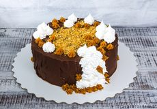 Chocolate cake with merengue and salted caramel Royalty Free Stock Photo