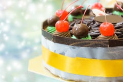 Chocolate cake with merry christmas xmas style. Close Up Chocolate cake with merry christmas xmas style on light effect background Royalty Free Stock Photography