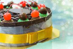 Chocolate cake with merry christmas xmas style. Close Up Chocolate cake with merry christmas xmas style on light effect background Stock Photo