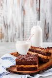 Chocolate cake with milk on a wooden background stock photo