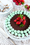 Chocolate Cake with mint cream and Strawberries Stock Photo