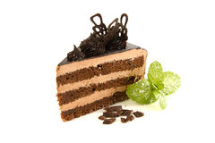 Chocolate cake with mint, white plate. White wood background, top view Stock Photography