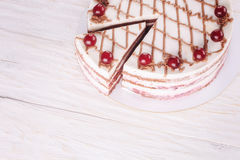 Chocolate cake with mousse, decorated cherries Royalty Free Stock Images