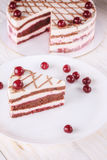 Chocolate cake with mousse, decorated cherries Stock Photography
