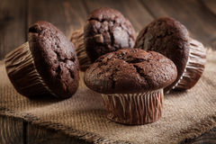 Chocolate cake muffins on a table Royalty Free Stock Photography