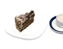 Chocolate cake and mug with a cappuccino Royalty Free Stock Images